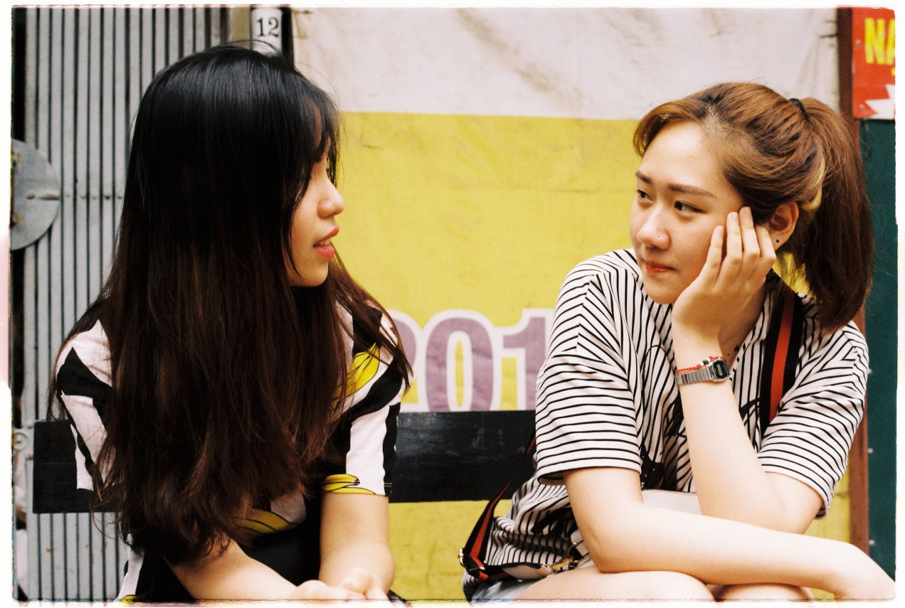 two female friends sitting and talking